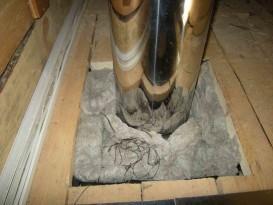 Место прохода дымоходной трубы через потолочное перекрытие