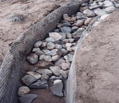 Укладка первого слоя бутового камня