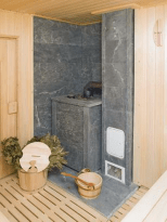 Каменка в бане около двери