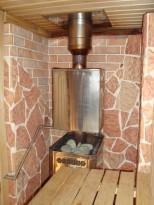 Терракотовая плитка в бане на стене