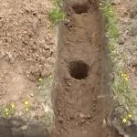 Траншея под ростверк и пробуренные скважины для столбов