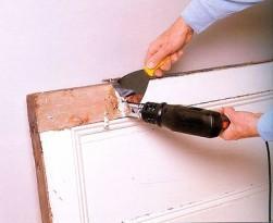 Удаление краски шпателем и строительным феном