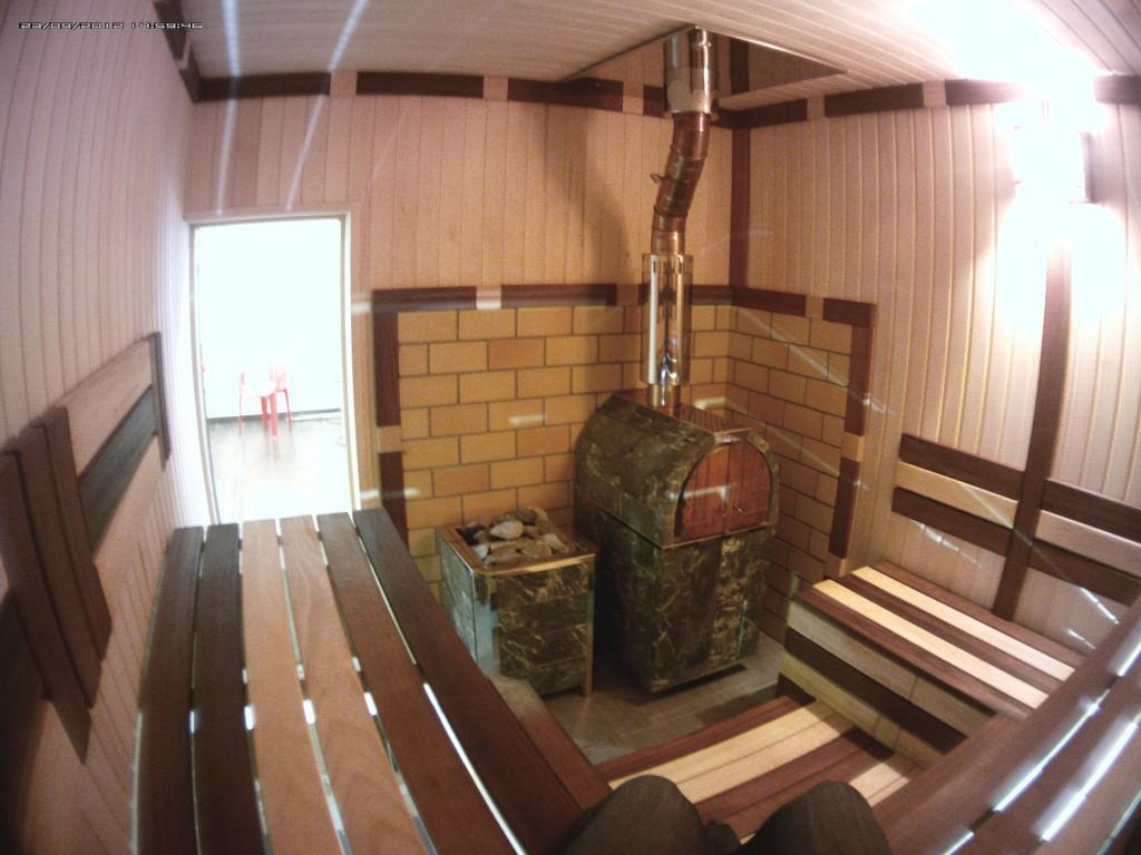 Печь дровяная чугунная Калита с тоннелем, в облицовке арочная (змеевик)