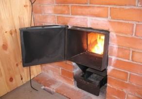 Печь, в которую дрова закладывают из предбанника