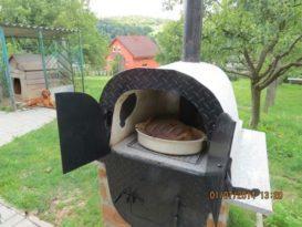 Готовая печь, сделанная из старой ванны